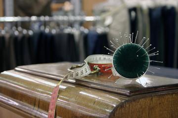Nadelkissen und Massband im Schneiderhandwerk
