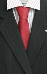 Nadelstreifenanzug und rote Krawatte - dresscode