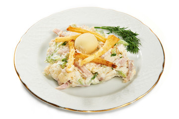 Potato salad, ham, cucumber and eggs on plate