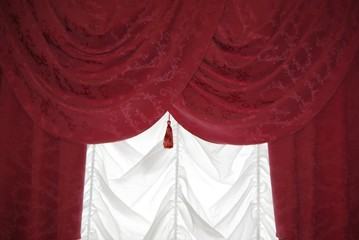 Red curtain on white