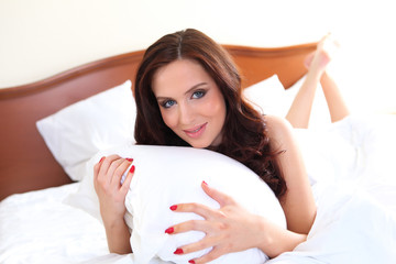 portrait of a young woman in bed