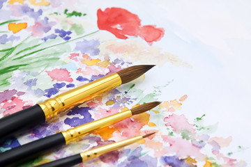 Paint brushes on watercolor illustration