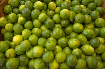 Limes bunched together on a local farm stand