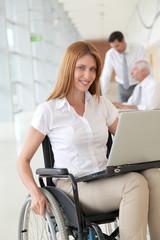 Businesswoman in wheelchair at work
