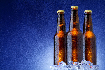 Ice Cold Beer in the Rain on Blue Background