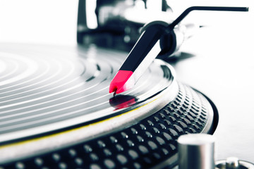Turntable playing vinyl with music