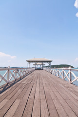 White bridge in to the sea with blue sky vertical