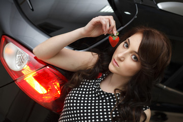 Young woman with New car