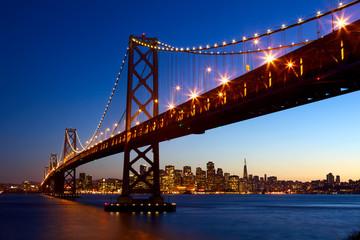 San Francisco skyline and Bay Bridge at sunset, California, USA