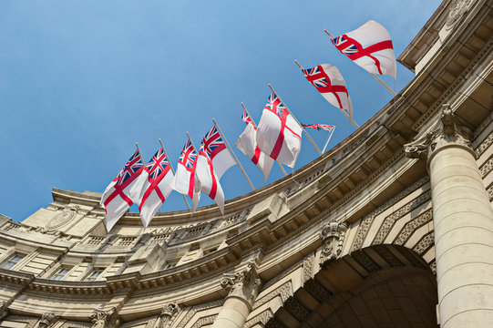 White Ensign flags on Admiralty Arch, London, England, UK
