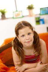 Cute little girl on couch