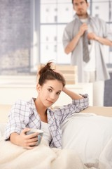 Young woman drinking morning tea in bed