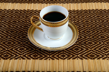 cup of coffee on the tablecloth