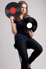 girl with two musical records