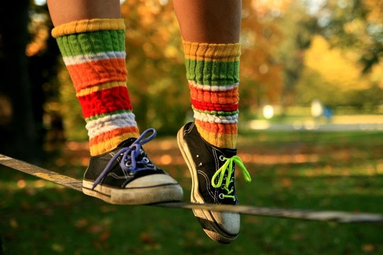 Walking the slackline in sneakers and colour socks