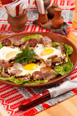 Foto op Canvas Assortiment sausage and eggs for breakfast