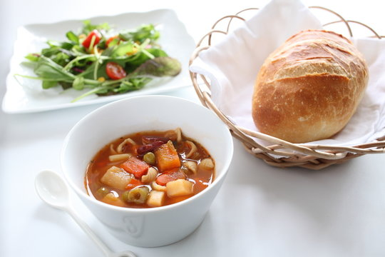 Minestrone soup with bread and green salad
