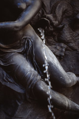 A stream of water from a bronze fountain