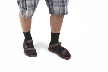 man wearing sandals with socks and having hairy legs.