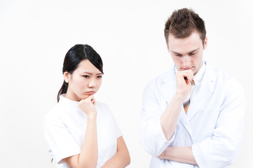 young doctor and nurse thinking