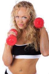 Athlete is lifting dumbbells