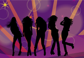 Silhouettes of fashionable girls dancing at the disco