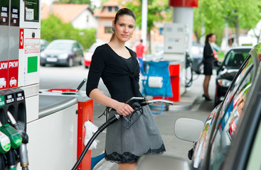 woman in petrol station
