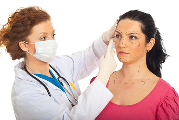 Doctor prepare woman for plastic surgery