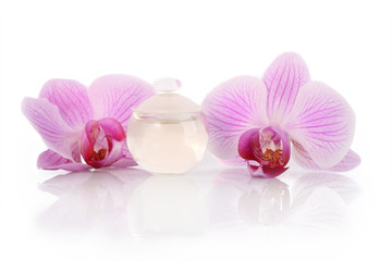 Perfume bottle and orchid flowers
