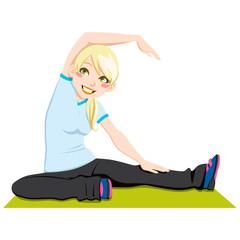 Gorgeous blonde woman exercising stretching workout