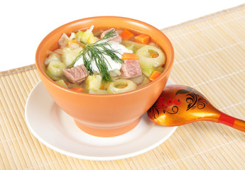 Cabbage soup with sour cream in a ceramic bowl