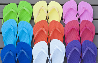 Colorful Flip Flops on a Deck