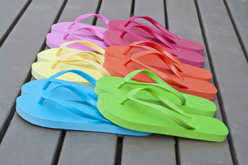 Colorful Flip Flops on a Deck