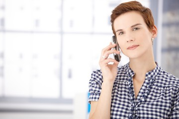 Portrait of woman on call