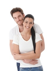 Portrait of happy young couple smiling