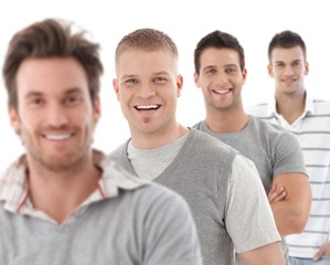 Group portrait of happy young men