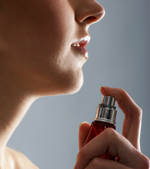 A close-up image of adding a healthy spray to the body