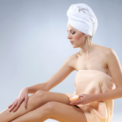A young Caucasian woman is pamperig her healthy body