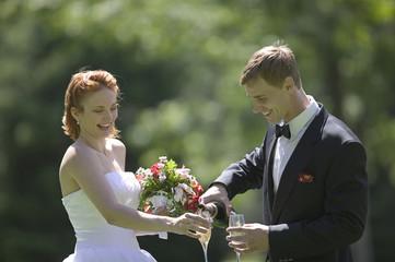 Bride and Groom Celebrating Outside in Garden