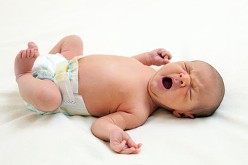 One week old baby boy yawning