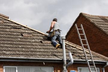 Workman repairing a roof