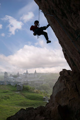 Silhouette of rock climber against medieval castle