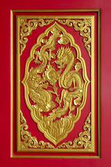 Golden dragon on red door