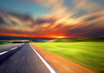 Blurred Road with blurred sky and sunset Wall mural