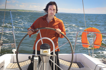 Young Man is Sailboat Captain