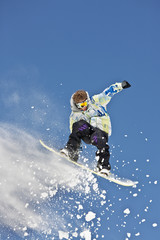 Snowboarder Hanging in Mid-Air Making Jump
