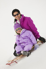 Mother and Daughter on A Sled