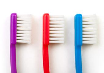 three toothbrushes white background