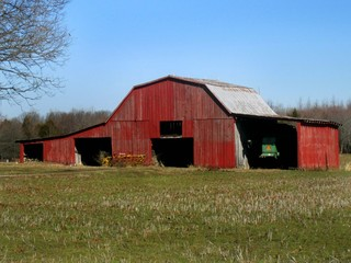 Rustic old red barn in summer