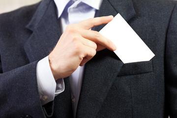 Blank card in businessmen hand